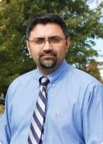 Kevin Munish. Comar, M.D.