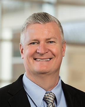 John Oestreicher, PhD