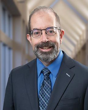 Scott E. Phillips, MD, FACS, FAAOA